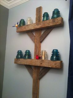 Antique insulators and barn wood became an awesome train electric pole for little boy train room