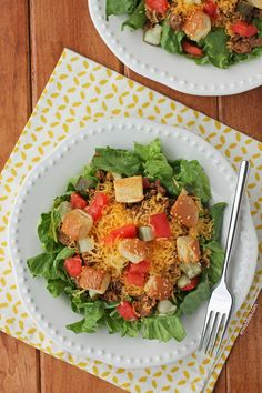 This Cheeseburger Salad is meaty, cheesy, satisfying and healthy! It even uses a bun for croutons. Just like a cheeseburger, in salad form. 280 calories or 7 Weight Watchers points per serving. www.emilybites.com