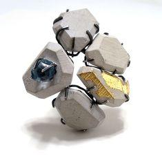 Iconic Interpretation - 2011   cast concrete, sterling silver, faux sapphire paste, faux gold leaf