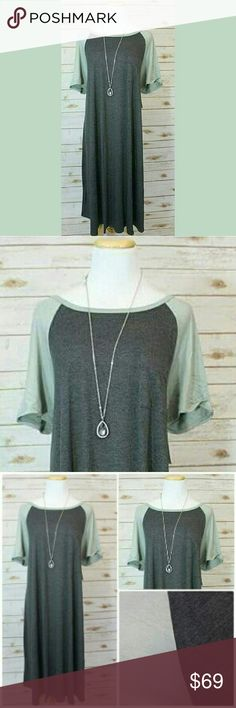 Charcoal and light mint green Carly Charcoal Carly with light mint green sleeves.  PRICE FIRM. LuLaRoe Dresses