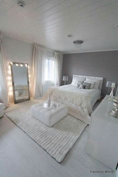 White bedroom & loving the ottoman in the middle