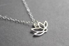 Another cute lotus necklace. Very simple. Suited to day to day wear for me.