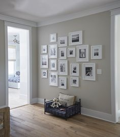 Gallery Wall Collage | White Picture Frames | Hallway Art Collage | Family Portraits in Black and White | Designer Linda Holman | Home Decor | Coastal Decor | Interior Design | Coastal Interiors | Interior Design Ideas | 30A | Florida | Sweet Bay | Lovelace Interiors