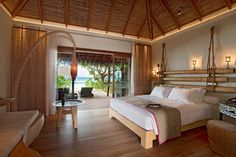 Wonderful Relaxation Resorts for Your Retreats: Ethnic Arch Lamp Wood Low Profile Bed Relaxing Nightlight Bamboo Bed Headboard Idyllic Resort ~ apcconcept.com Hotel