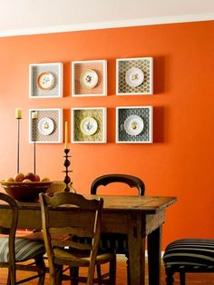 Kitchen art - decorative plates mounted on patterned paper or fabric  in frames