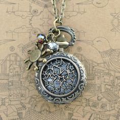 Vintage star pocket watch necklace with antique bronze sun charm and crystal charm. $4.99, via Etsy.