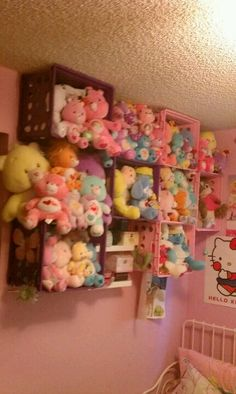 File crates mounted to the wall as a storage or display solution for stuffed animals.