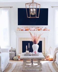 Colourful pink and orange pumpkin mantle.