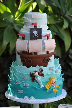 Pirate & Mermaid Party Cake. Cool idea for a joint boy/girl birthday party...perfect for the twins