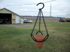 Love this idea!!!!  Ask Jeri for used horseshoes ;)