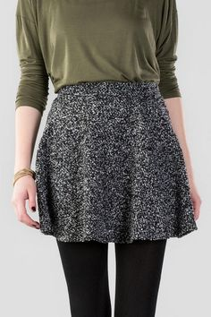 """The Marissa Tweed Skirt is the perfect skirt for accessorizing! A black & white knit tweed makes up this a-line skirt that looks great with a pair of tights & ankle boots.<br /> <br /> - 16"""" length<br /> - 26"""" waist<br /> - 74"""" sweep<br /> - measured from a size small<br /> <br /> - 100% Polyester<br /> - Hand Wash<br /> - Imported"""