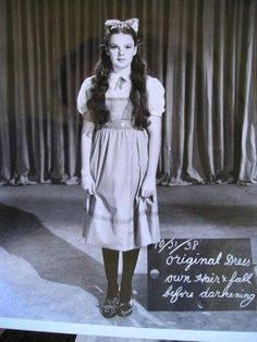 """October 31, 1938, MGM Studios Judy Garland as Dorothy Gale in a costume&make up test photograph during production of the Wizard of Oz. You can see the chalkboard notes,  """"original dress&hair darkened fall"""""""