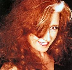 Bonnie Raitt-Oh I LOVE her! She ROCKS the guitar and the blues!