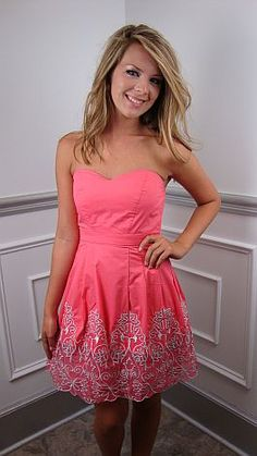 "It's summer time and you know what that means... a million parties and events dotting your day planner! Now... what are you going to wear? How about THIS! This coral dress is 100% cotton with intricate embroidery and a flattering sweetheart neckline. The tailored waistline is perfectly balanced by a full skirt with just enough ""puff"" :) Leave the strapless bra behind, if you wish - this dress has built in cups! (Back zip. Fully-lined)  $64"