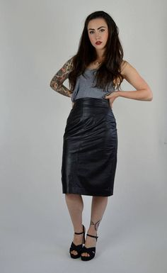 Gorgeous vintage leather skirt! The perfect tight 80s pencil fit. Done in a black leather with a rayon lining. Great waist seaming for the perfect flattering fit! Center back zipper and snap button.  SIZE: XS LABEL: 6 BRAND: Chia  Excellent Vintage Condition  Measurements: Waist: 25 Hips: 36 Length: 24.5  Brook-Lynnes Measurements; bust: 28 waist: 25 hips:32 Height: 5 1  *Any overpayment exceeding $4 USD will be refunded back to your account.  *All items are measured in US inches, Shoes are…