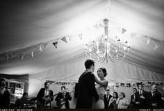 Wedding couple have their first dance as the band look on