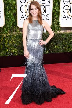 """The custom couture confection featured her favorite thing, """"feathers""""—and she wore them well. Getty  - HarpersBAZAAR.com"""