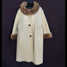 """Vtg Tan Textured Wool Mink Collar Cuffs Coat ILGWU Tan textured wool raglan sleeve Mink collar, Mink cuffs ILGWU USA tag very nice vintage condition with flaw, seam pulling, and ripping at interior lining at armholes (unseen) when wearing ✂------measurements------- (all taken with the garment laying flat)  Chest 26""""  Shoulders 18"""" Length back of Neck to Hem 42"""" Waist 26"""" Sweep 40"""" across at hem Large 100% will coat Mink collar and cuffs 1-1/4"""" Faux Woven leather Buttons Vintage…"""