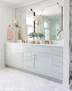 "The double vanity is painted in Sherwin-Williams's ""Contented,"" which is the same color seen on the walls throughout much of the home. 