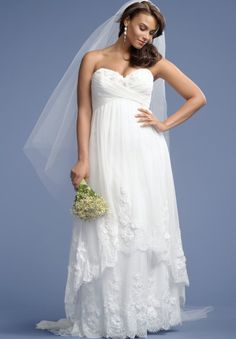 Prettiest 8 Plus Size Summer Wedding Dresses: Stunning strapless sweetheart plus size summer wedding dress with cascading lace overskirt