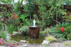 Love this DIY backyard fountain. We've been wanting a water feature along our back fence and this would be pretty and fun for the kiddos.