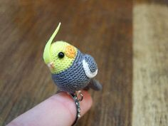 tiny ami-cockatiel ring - I want to make this and give it to someone just to see the look on her face.