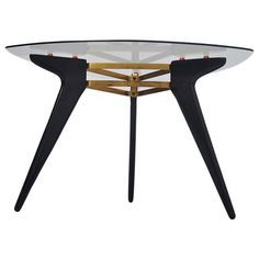Belgian coffee table in the manner of Alfred Hendrickx 1950 | From a unique collection of antique and modern coffee and cocktail tables at https://www.1stdibs.com/furniture/tables/coffee-tables-cocktail-tables/