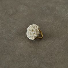 Coral and gold ring.