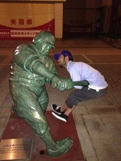 34 People Having Fun with Statues