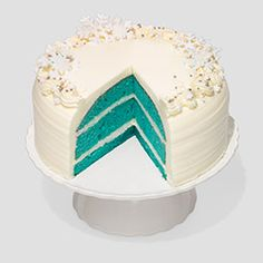 """Gayle fell hard for this blue velvet cake with cream cheese icing and sugar snowflakes. Just add coffee, milk, or a flute of Champagne.""--Oprah"