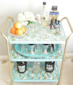 Find out how one blogger turned a $2 yard sale purchase into a elegant bar cart . . .