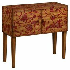 """Two-door wood cabinet with a red scrolling leaf and floral motif.  Product: CabinetConstruction Material: WoodColor: Brown and redFeatures:  Two doorsFloral motif Dimensions: 34"""" H x 36"""" W x 15.5"""" D"""