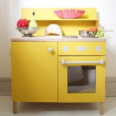 Handmade mustard-yellow wooden toy kitchen available from littlegoldie.com