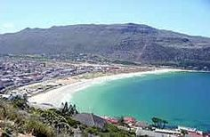 Fish Hoek boasts a long stretch of a white sandy beach, and is one of the safest and warmest swimming beaches in the Cape. You can take a relaxing stroll down Jager's walk, which runs along the mountainside of Fish Hoek beach. Visitors can view the dolphins and whales that visit these shores annually. refrhttp://www.capetownhappenings.co.za/images/fishhoek.jpg