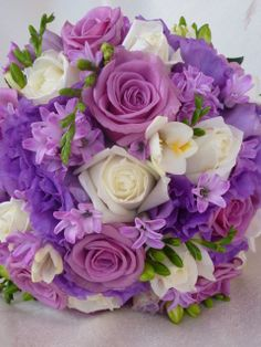 Posy of Mauve and White Roses with Purple Lissianthus and Purple Hyacinths