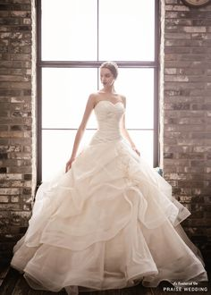 This sweet gown from Angelos Wedding featuring layers of romance is stealing our hearts! » Praise Wedding Community