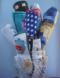 A cookie jar is a great way to showcase your little quilts. highroadquilter.blogspot.com
