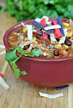 Slow Cooker Chicken Enchilada Soup with Skinless Chicken Breasts, Low Sodium Chicken Stock, Red Enchilada Sauce, Black Beans, Diced Tomatoes, Whole Kernel Corn, Drained, Diced Green Chiles, Garlic, Onion, Ground Cumin.