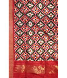 Red Pure Handloom Ikkat Pochampally Silk Saree -----Elegant looking Red Ikkat  Pochampally silk saree gives indeed a beautiful look with grace. This saree is no doubt one of the beautiful collection for your wardrobe.-----Sarees from luxurionworld.com
