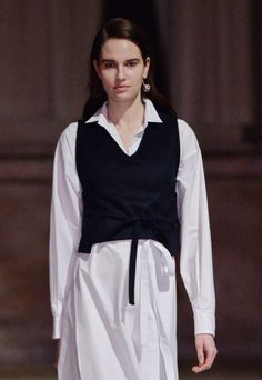 Fitted waistcoats rest atop long white shirting at the @CreaturesofcomfortNYLA #NYFW #AW15 show