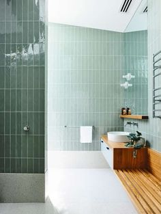 What do you think of the use of vertical tiles in this dreamy green bathroom? It's the little details that can make all the difference. 🙌 Green bathroom goals with all the trimmings from the Moving House by clever cats 🌿⚡️️💦 📷 Bathroom Trends, Bathroom Inspo, Laundry In Bathroom, Bathroom Inspiration, Small Bathroom, Bathroom Ideas, Mint Bathroom, Bathroom Remodeling, Green Bathroom Tiles