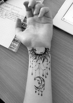 Intricate Arm Moon Tattoo with Designs.