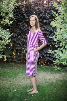 Switch up your stripes in this stretchy dress with pockets! Burgundy and  white striped with elbow sleeves  Model is 5'10'' wearing size Small