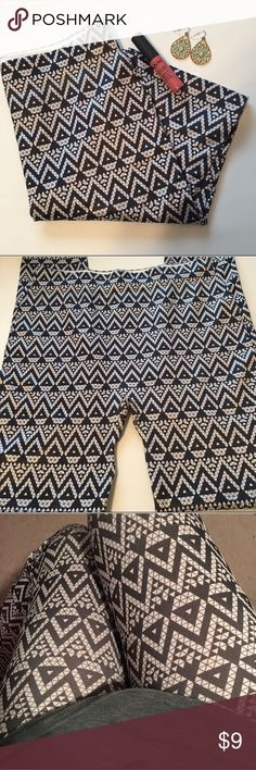 """Geometric Leggings These leggings have never been worn except for the model photo.  They are size M/L but I'd say they fit smaller. They are also kinda sheer and very stretchy.  Waist: 23"""" Inseam: 25"""" Size: M/L Material: 96% Polyester ; 4% Spandex Condition: NWOT Pants Leggings"""