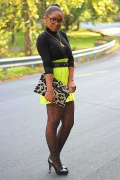 Courtnie of StyleLust Pages wearing a neon green skirt from J Crew, animal print clutch by Love, Courtnie