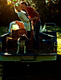 this has everything, a truck, pets, hay, and a cute couple