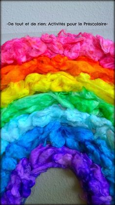 Fluffy rainbow with DYED COTTON BALLS on sticky wall paper. <3