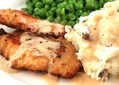 Country Chicken Gravy    chicken drippings from pan  1 cup hot water  1-4 Tablespoons leftover seasoned flour   1 can evaporated milk  2-3 Tablespoons water