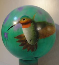 airbrush painted bowling ball to use as garden globe   artist: tony