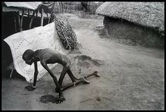 James Nachtwey - Sudan - A famine victim too weak to stand, entered an ...